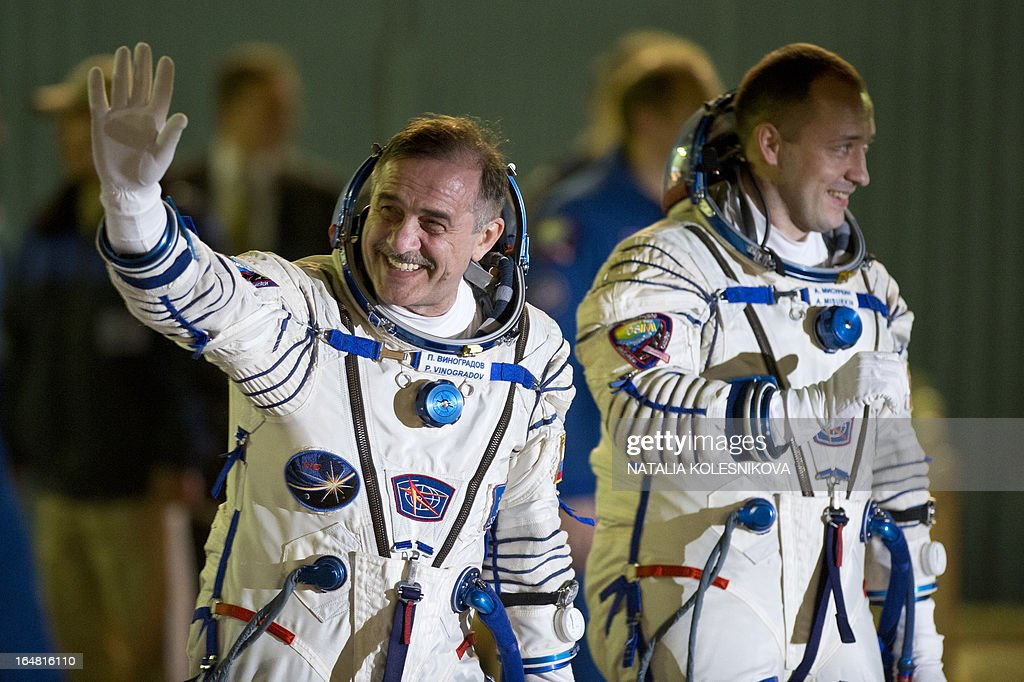 Crew members of the next expedition to the International Space Station (ISS), Russian cosmonauts Pavel Vinogradov (L) and Alexander Misurkin wave prior to the launch of the the Soyuz TMA-08M spacecraft at the Russian-leased Baikonur cosmodrome on March 28, 2013. US astronaut Christopher Cassidy, Russian cosmonauts, Pavel Vinogradov and Alexander Misurkin are set to blast off early on March 29 for the International Space Station (ISS) aboard a Soyuz TMA-08M spacecraft. The launch of the Soyuz TMA-08M spacecraft with Christopher Cassidy, Pavel Vinogradov and Alexander Misurkin aboard is scheduled on March 29, 2013. AFP PHOTO/NATALIA KOLESNIKOVA