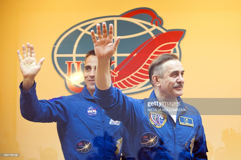 Crew members of the next expedition to the International Space Station (ISS), US astronaut Christopher Cassidy (L) and Russian cosmonaut Pavel Vinogradov (R) wave to relatives and friends after a press conference at the Russian leased Kazakhstan's Baikonur cosmodrome, on March 27, 2013. The launch of the Soyuz TMA-08M spacecraft with Cassidy, Vinogradov and Misurkin aboard is scheduled on March 29.