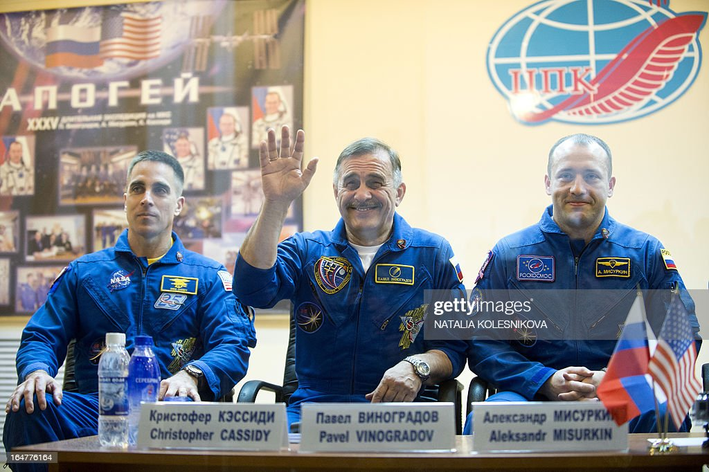 Crew members of the next expedition to the International Space Station (ISS), (L-R) US astronaut Christopher Cassidy, Russian cosmonauts, Pavel Vinogradov and Alexander Misurkin, attend a press conference at the Russian leased Kazakhstan's Baikonur cosmodrome, on March 27, 2013. The launch of the Soyuz TMA-08M spacecraft with Cassidy, Vinogradov and Misurkin aboard is scheduled on March 29. AFP PHOTO/NATALIA KOLESNIKOVA