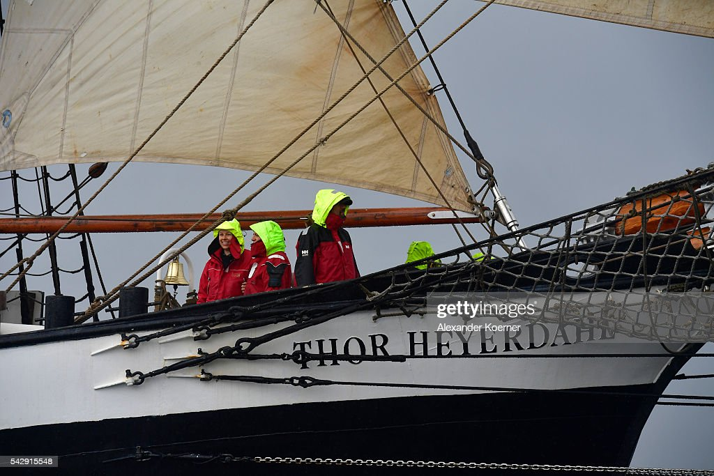 Crew members of the sailing ship 'Thor Heyerdahl' stand on deck while sailing out of the Bay of Kiel during the annual Windjammer parade on June 25, 2016 in Kiel, Germany. The annual Tall Ships Parade, in which many of the world's largest traditional sailing ships participate, is the highlight of the Kieler Woche (Kiel Week), the world's biggest regatta and sailing event.