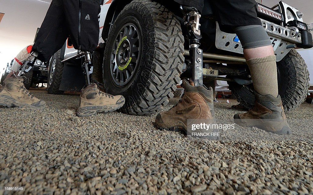 Crew members of the team Race 2 Recovery, consisting of British and US soldiers who have suffered serious injuries in the conflicts in Iraq and Afghanistan in recent years, remain next to a vehicle in Lima on January 3, 2013, ahead of the 2013 Dakar Rally which this year will thunder through Peru, Argentina and Chile from January 5 to 20.