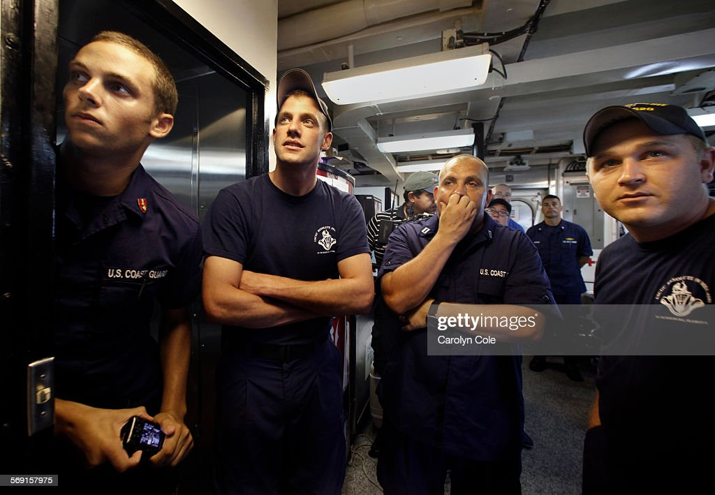 MEXICO––JULY 15 2010––Crew members of the US Coast Guard Cutter Resolute watch the news of the oil no longer spilling into the Gulf of Mexico as the...