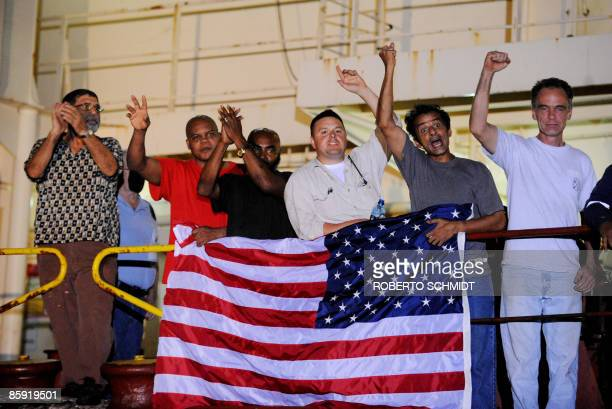Crew members of the US merchant ship Maersk Alabama exault as they speak with the media moments after hearing that the captain of their ship which...