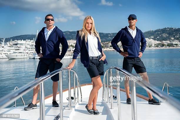 Crew members on luxury yacht