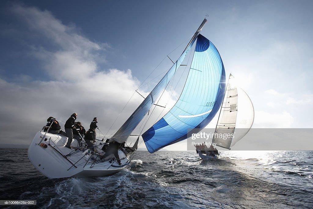 Crew members on racing yacht