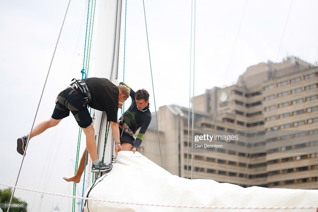 Crew members pack up the sails of one of the race yachts competing in The Clipper 2013-14 Round The World Yacht Race, as moored in St Katherine's Dock, east London on August 23, 2013. The 40,000 mile, 8-leg course begins on September 1 and will visit six continents, taking eleven months to complete.