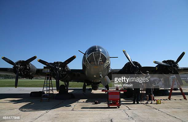 Crew members perform maintenance on the World War II Era Boeing B17 nicknamed Memphis Belle on August 26 2014 in Baltimore Maryland Though it is not...