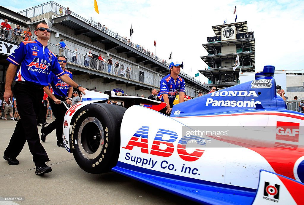 Crew members push the #14 ABC Supply Co./A.J. Foyt Racing Honda driven by Takuma Sato of Japan through Gasoline Alley during practice for the 2013 Indianapolis 500 at Indianapolis Motor Speedway on May 17, 2013 in Indianapolis, Indiana.