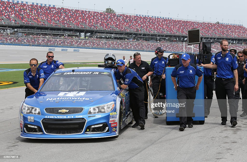 Crew members push the car of Dale Earnhardt Jr, driver of the #88 Nationwide Chevrolet, on the grid during qualifying for the NASCAR Sprint Cup Series GEICO 500 at Talladega Superspeedway on April 30, 2016 in Talladega, Alabama.
