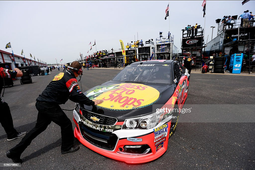 Crew members push the car of Tony Stewart, driver of the #14 Bass Pro Shops Chevrolet, through the garage area during practice for the NASCAR Sprint Cup Series GEICO 500 at Talladega Superspeedway on April 29, 2016 in Talladega, Alabama.