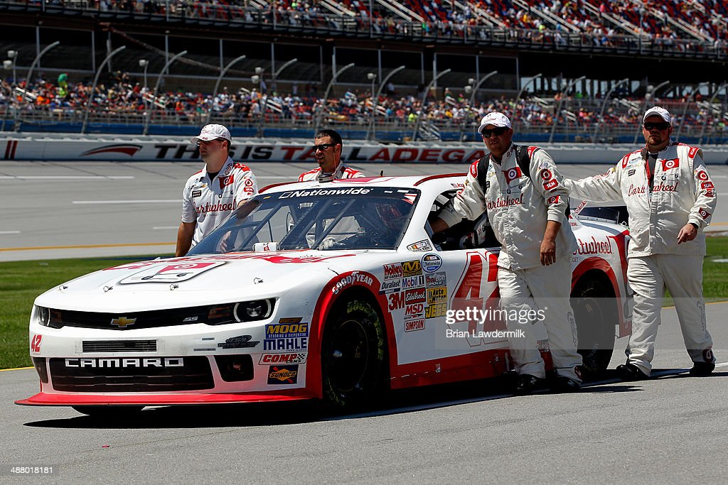 Crew members push the #42 Cartwheel Chevrolet, driven by Kyle Larson, on pit road prior to the NASCAR Nationwide Series Aaron's 312 at Talladega Superspeedway on May 3, 2014 in Talladega, Alabama.