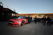 Crew members push the Chevrolet through inspection during qualifying for the NASCAR Sprint Cup Series Folds of Honor QuikTrip 500 at Atlanta Motor...