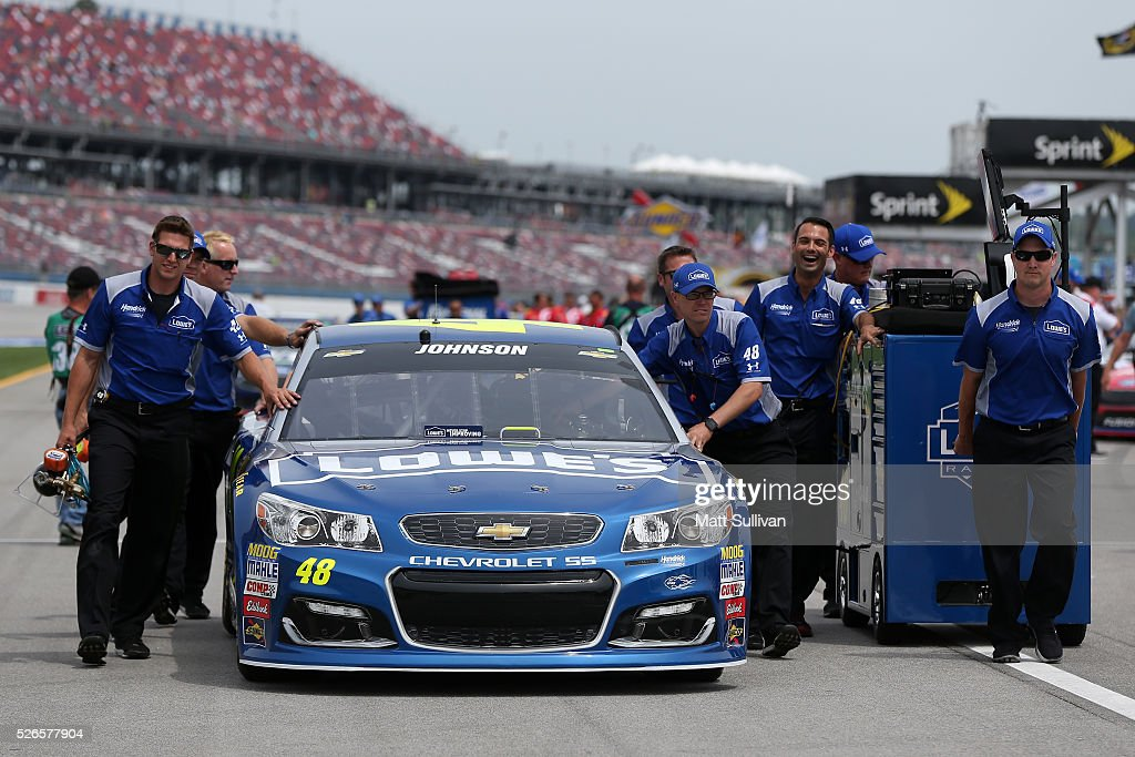 Crew members push the #48 Lowe's Chevrolet of Jimmie Johnson on the grid during qualifying for the NASCAR Sprint Cup Series GEICO 500 at Talladega Superspeedway on April 30, 2016 in Talladega, Alabama.