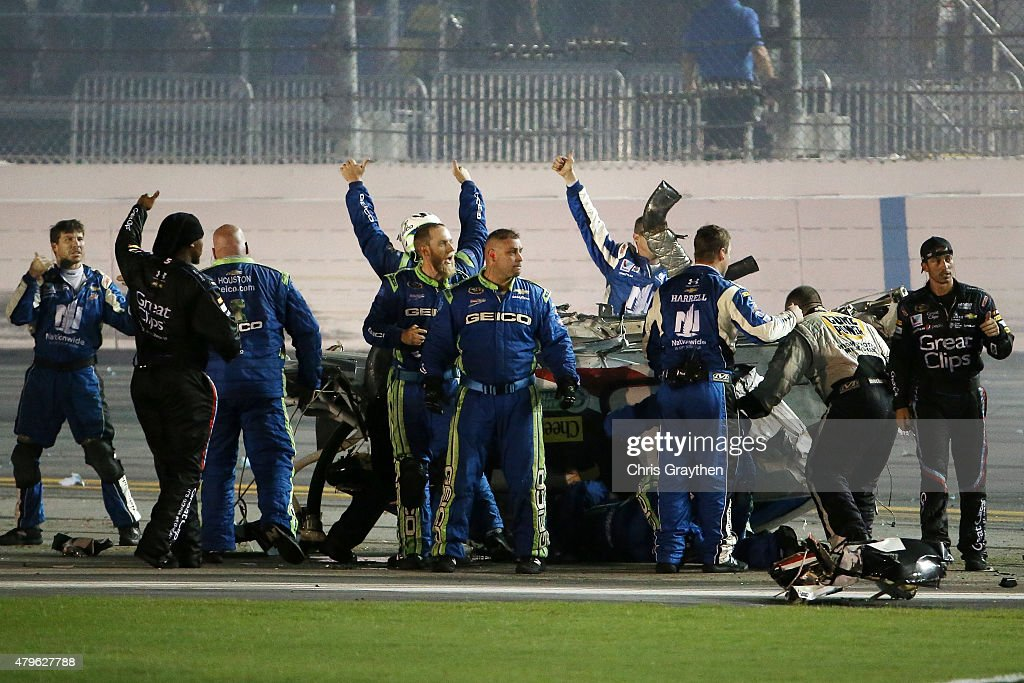 Crew members react after checking on Austin Dillon, driver of the #3 Bass Pro Shops Chevrolet, following an on-track incident during the NASCAR Sprint Cup Series Coke Zero 400 Powered by Coca-Cola at Daytona International Speedway on July 6, 2015 in Daytona Beach, Florida.