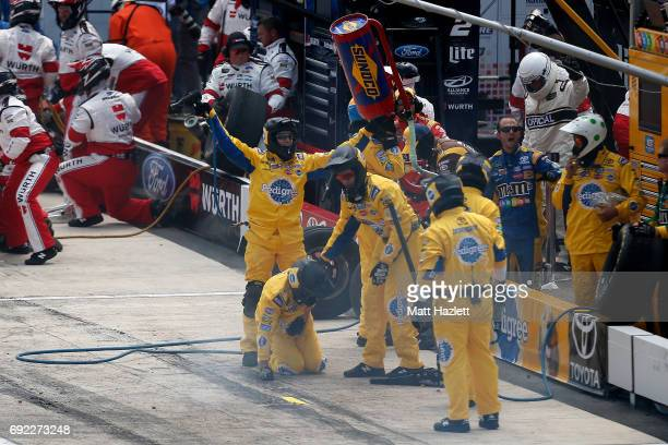 Crew members react after Kyle Busch driver of the Pedigree Petcare Toyota leaves pit road with a loose wheel during the Monster Energy NASCAR Cup...