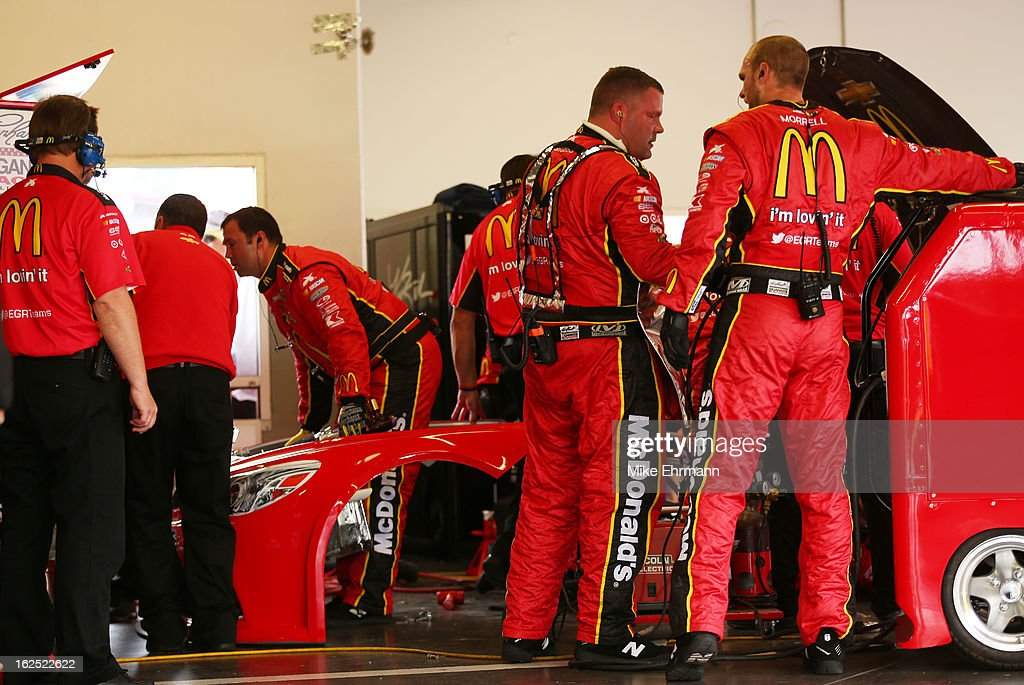 Crew members repair the #1 McDonald's Chevrolet, driven by Jamie McMurray, after an incident during the NASCAR Sprint Cup Series Daytona 500 at Daytona International Speedway on February 24, 2013 in Daytona Beach, Florida.