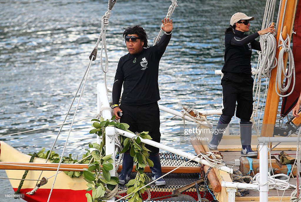 Crew members wave goodbye to friends and family as Waka Tapu departs from Viaduct Harbour, for a four month return voyage to Rapa Nui (Easter Island), on August 17, 2012 in Auckland, New Zealand. The 10,000 nautical mile voyage will retrace the ancestors of Maori when they first travelled across the Pacific to make their home in New Zealand.