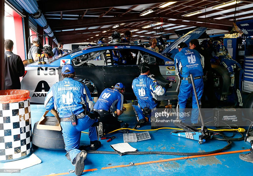 Crew members work on the car of Dale Earnhardt Jr, driver of the #88 Nationwide Chevrolet, in the garage area during the NASCAR Sprint Cup Series GEICO 500 at Talladega Superspeedway on May 1, 2016 in Talladega, Alabama.