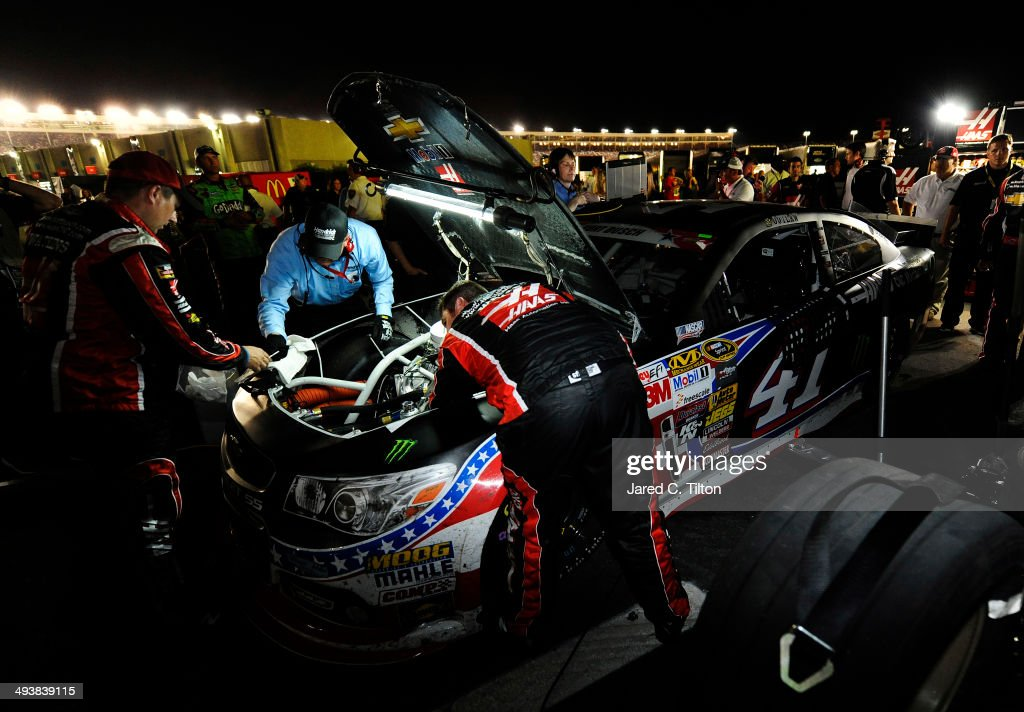 Crew members work on the car of Kurt Busch, driver of the #41 Haas Automation Made in America Chevrolet, in the garage area after he blew his engine during the NASCAR Sprint Cup Series Coca-Cola 600 at Charlotte Motor Speedway on May 25, 2014 in Charlotte, North Carolina.