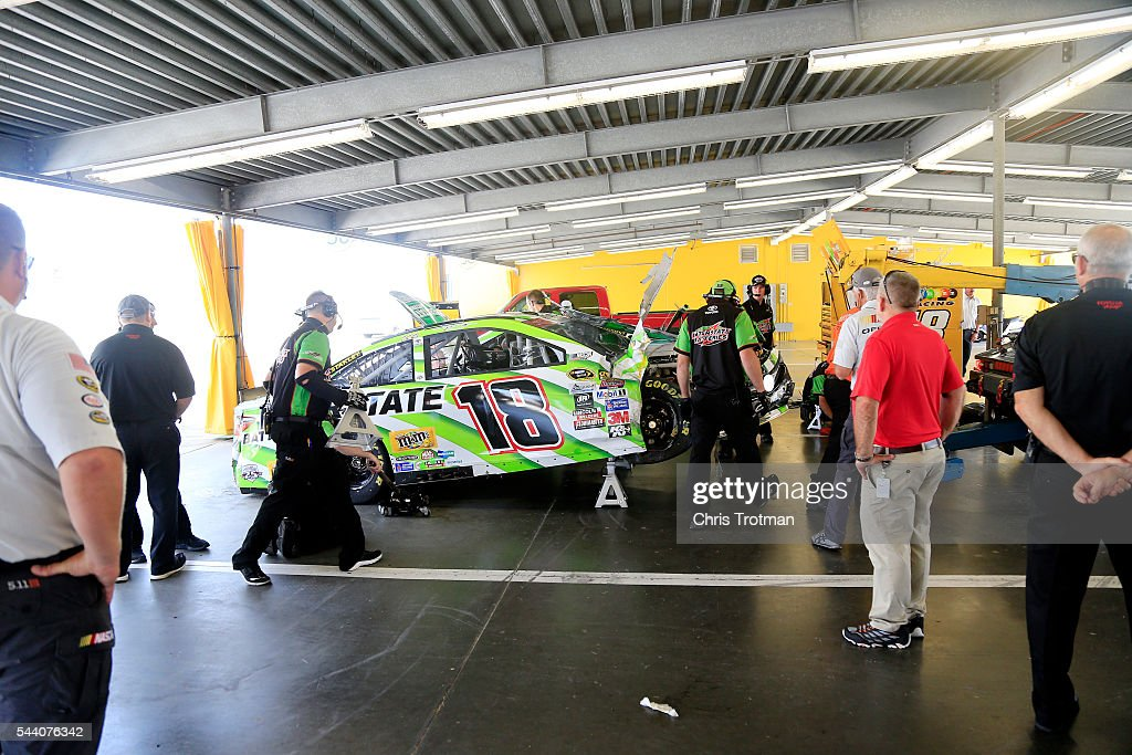 Crew members work on the car of Kyle Busch, driver of the #18 Interstate Batteries Toyota, after an on track incident during practice for the NASCAR Sprint Cup Series Coke Zero 400 at Daytona International Speedway on July 1, 2016 in Daytona Beach, Florida.