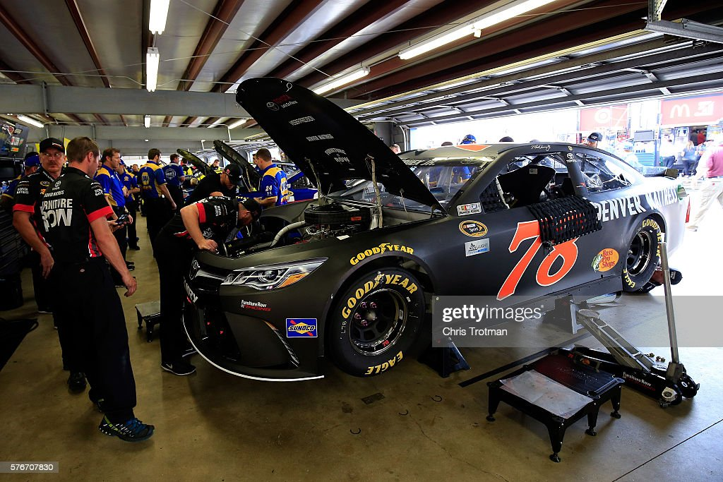 Crew members work on the #78 Furniture Row Toyota, driven by Martin Truex Jr(not pictured), prior to the NASCAR Sprint Cup Series New Hampshire 301 at New Hampshire Motor Speedway on July 17, 2016 in Loudon, New Hampshire.