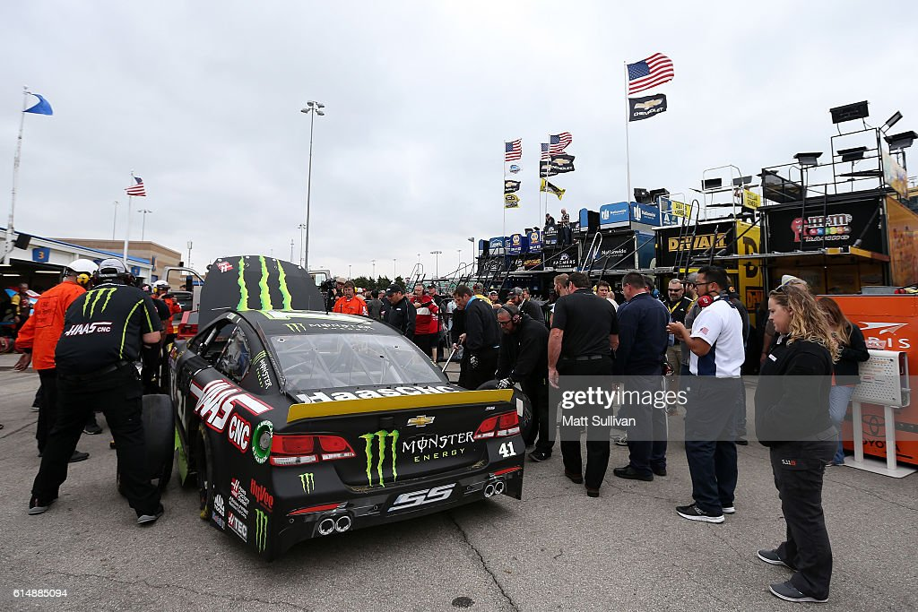 Crew members work on the #41 Monster Energy/Haas Automation Chevrolet, driven by Kurt Busch(not pictured), after being involved in an on-track incident during practice for the NASCAR Sprint Cup Series Hollywood Casino 400 at Kansas Speedway on October 15, 2016 in Kansas City, Kansas.