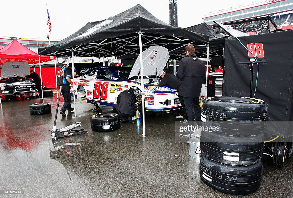 Crew members work on the #88 National Guard/Diet Mountain Dew Chevrolet of <a gi-track='captionPersonalityLinkClicked' href=/galleries/search?phrase=Dale+Earnhardt+Jr.&family=editorial&specificpeople=171293 ng-click='$event.stopPropagation()'>Dale Earnhardt Jr.</a> prior to the NASCAR Sprint Cup Series Food City 500 at Bristol Motor Speedway on March 18, 2012 in Bristol, Tennessee.