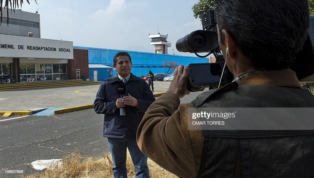 A crew of a local TV station reports in front of Tepepan prison as they wait the arrival of Bernard Cassez, father of French Florence Cassez, in Mexico city on January 23, 2013. Mexican Supreme court will take Wednesday a new resolution about the situation of Florence Cassez, sentenced to 60 years of imprisonment in Mexico.