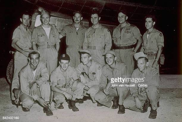 Crew of Enola Gay before the takeoff Colonel Tibbets standing Captain Theodore Van Kirk navigator standing and Major Thomas Ferebee bombardier...