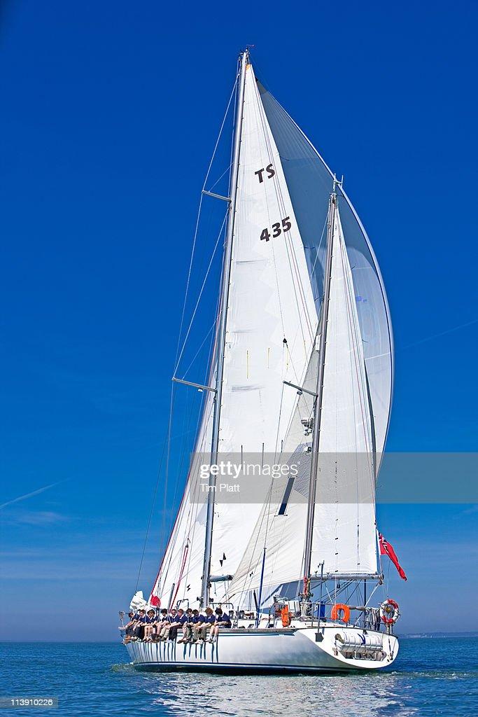 Crew of teenage boys on a sailing yacht. : Stock Photo