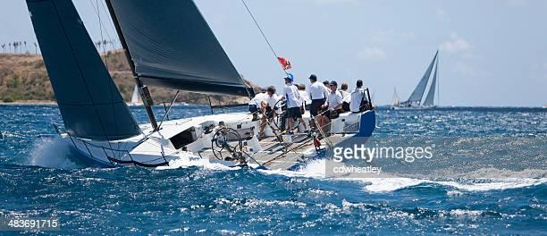 crew on a sailboat 'Highland Fling XII' racing in regatta