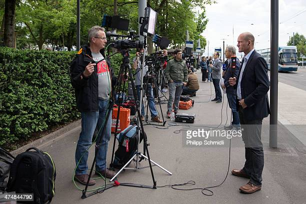 TV crew reports in front of the hotel Baur au Lac Zurich on May 27 2015 in Zurich Switzerland Swiss police on Wednesday raided a the Zurich hotel to...