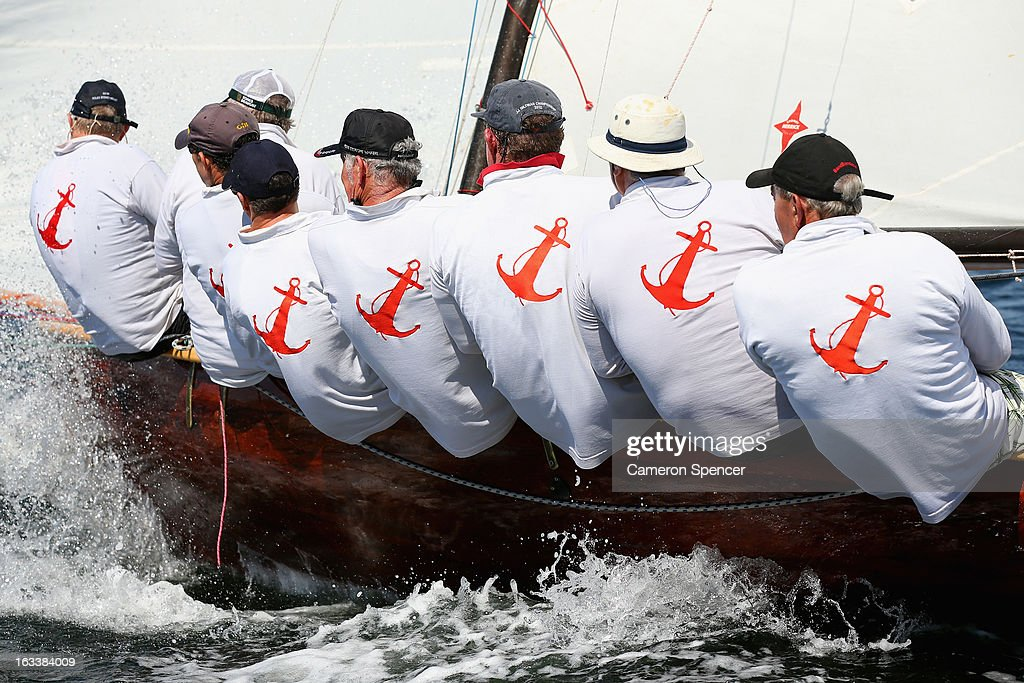 Crew ride the rail onboard 'Yendys' during the Sydney Regatta on Sydney Harbour, on March 9, 2013 in Sydney, Australia.