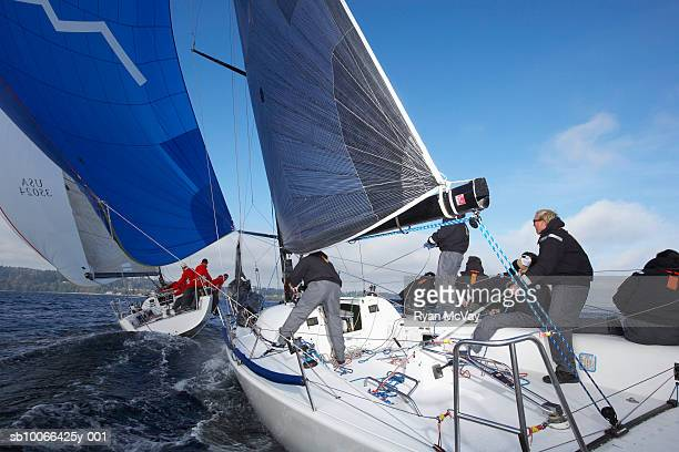 Crew sailing racing yacht