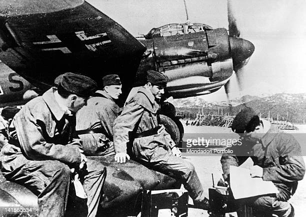 Crew waiting to take off in a German air base in the Caucasus Russia August 1942