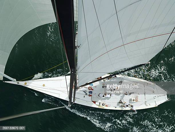 Crew working on deck of sailing ocean going racing yacht