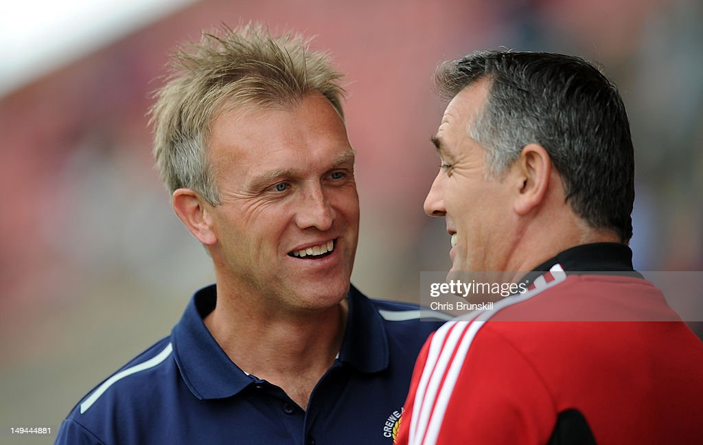 Crewe Alexandra manager Steve Davis chats with Bolton Wanderers manager Owen Coyle prior to the preseason friendly match between Crewe Alexandra and...