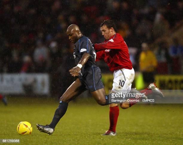 Crewe Alexandra's Dean Ashton and Burnley's Arthur Knohere battle for the ball