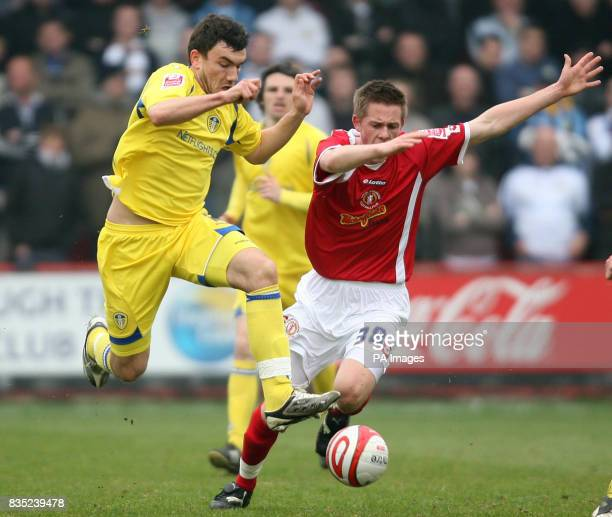 Crewe Alexandra's Gylfi Sigurdsson and Leeds United's Robert Snodgrass battle for the ball during the CocaCola League One match at Gresty Road Crewe