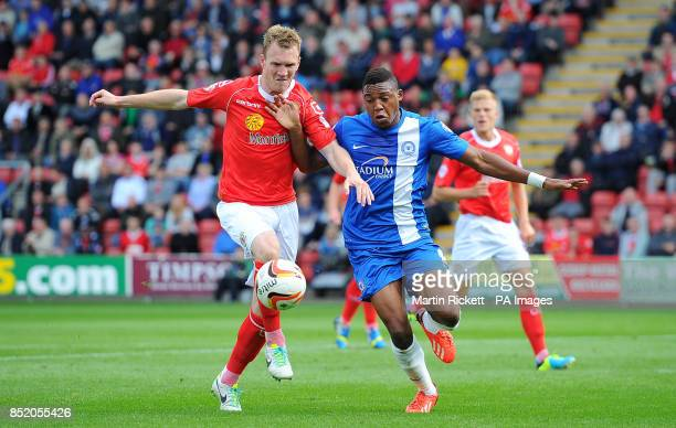 Crewe Alexandra's Mark Ellis battles for the ball with Peterborough United's Britt Assombalonga during the Sky Bet Football League One match at the...