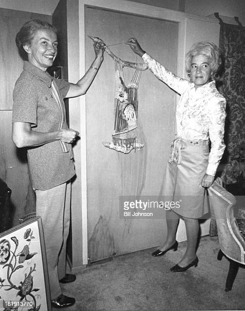 SEP 13 1972 SEP 17 1972 Crewel art displayed Oct 57 will include macrame wall hanging viewed by Mrs Rodney Davis left and Mrs Stanley Morese