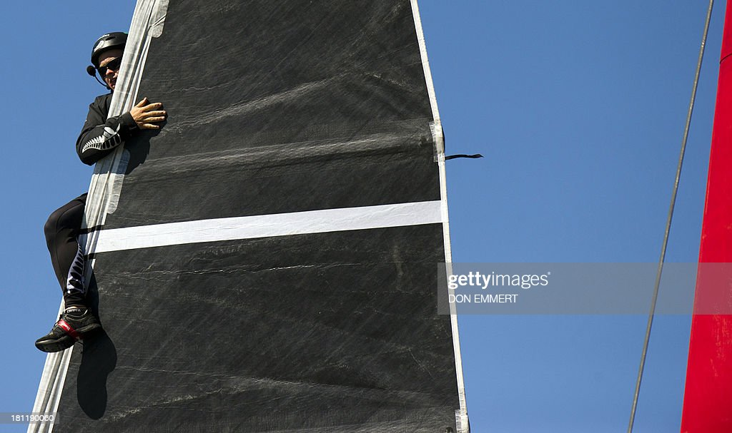 A crewmember aboard Emirates Team New Zealand as a sail change is made after the first race of the day during the 34th America's Cup September 19, 2013 in San Francisco. Team USA won the first race of the day and the second was postponed due to high winds. AFP PHOTO/Don Emmert