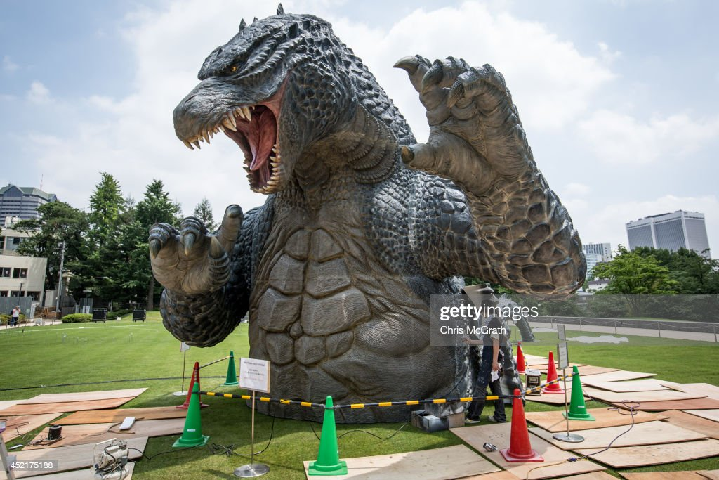 Crewmember Tetsuo Hayashi airbrushes the final touches to a 6.6 meter replica of the famous Godzilla at Tokyo Midtown on July 15, 2014 in Tokyo, Japan. The 'MIDTOWN Meets GODZILLA' project is in collaboration with the Japan release of the Hollywood film version of 'Godzilla' The Godzilla built on the lawns of Tokyo Midtown will host a light show everynight complete with mist, audio and fire rays.
