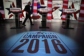 A crewmember walks on the stage prior to a Democratic presidential debate sponsored by CBS at Drake University on November 14 2015 in Des Moines Iowa...