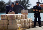 Crewmembers from the Coast Guard Cutter Northland offload approximately 3500 pounds of cocaine confiscated from a 35foot gofast vessel in the...