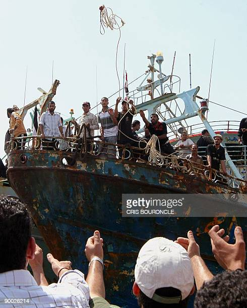 Crewmembers of the Egyptian fishing ship Momtaz I dock at Ataka port 170 kms northeast of Cairo on August 23 2009 Thirtyfour Egyptian fishermen who...
