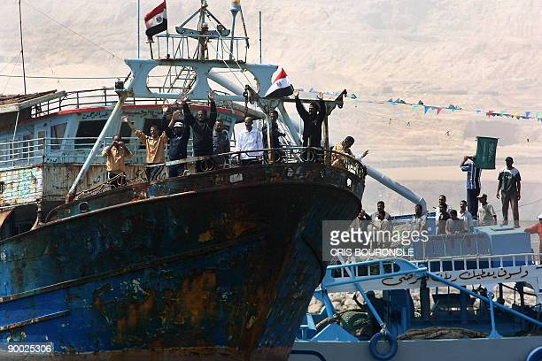 Crewmembers of the Egyptian fishing ship Momtaz I wave as they arrive at the port in Ataka 170 kms northeast of Cairo on August 23 2009 More than 30...