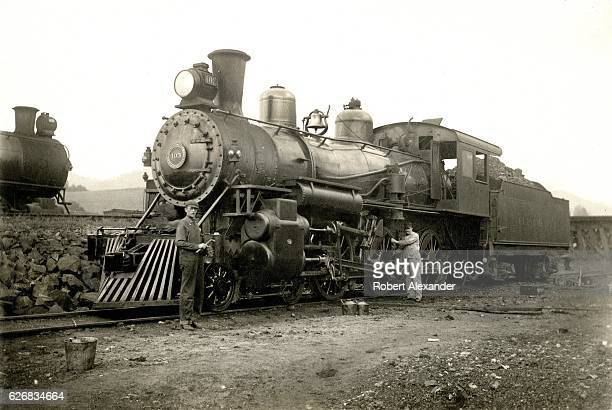 Crewmen work on Clinchfield Railroad steam locomotive No 103 circa 1910 Made by the Baldwin Locomotive Works in 1908 No 103 was a class G2 or...