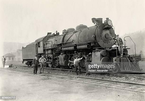 Crewmen work on Clinchfield Railroad steam locomotive No 558 circa 1920 Manufactured by the Baldwin Locomotive Works in 1910 No 558 was a class M2 or...