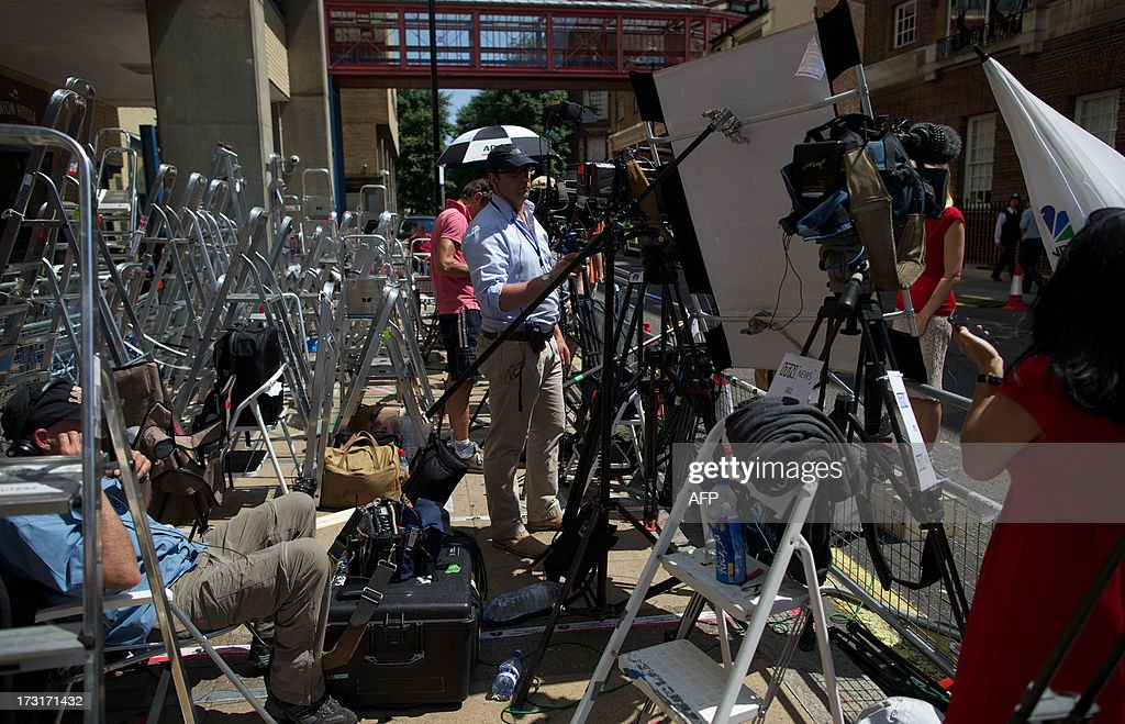 TV Crews and photographers set up inside the media pen outside the main entrance to the Lindo Wing of Saint Mary's Hospital in Paddington, west London on July 9, 2013. Prince William and his wife Catherine's baby, which will be third in line to the throne, will be born in the private Lindo wing of St Mary's Hospital, where William was born in 1982 and his brother Harry in 1984.